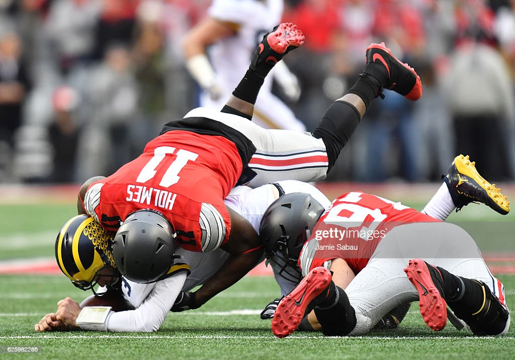 Nick Bosa #97 and Jalyn Holmes #11 of the Ohio State Buckeyes sack Wilton Speight #3 of the Michigan Wolverines in their game at Ohio Stadium on November 26, 2016 in Columbus, Ohio.