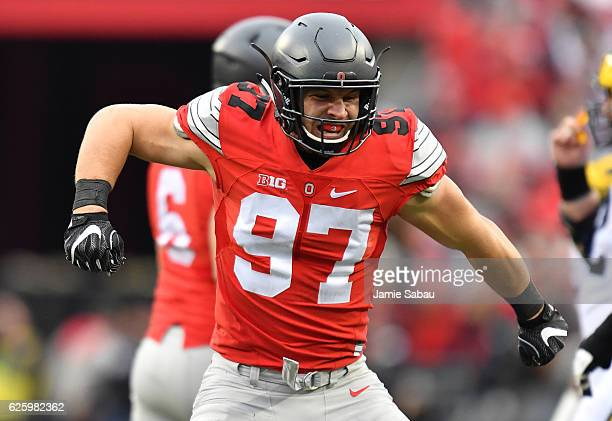 Nick Bosa of the Ohio State Buckeyes celebrates a sack against the Michigan Wolverines at Ohio Stadium on November 26 2016 in Columbus Ohio