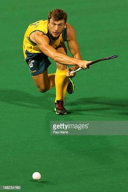 Nick Budgeon of Australia passes the ball during the International Test match between the Australian Kookaburras and Korea at Perth Hockey Stadium on...