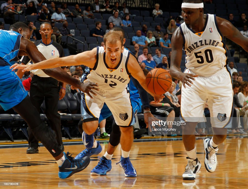 Nick Calathes #12 of the Memphis Grizzlies drives to the basket against <a gi-track='captionPersonalityLinkClicked' href=/galleries/search?phrase=Samuel+Dalembert&family=editorial&specificpeople=202026 ng-click='$event.stopPropagation()'>Samuel Dalembert</a> #1 of the Dallas Mavericks during a game on October 9, 2013 at FedExForum in Memphis, Tennessee.