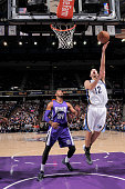 Nick Calathes of the Memphis Grizzlies shoots a layup against Jason Thompson of the Sacramento Kings on February 25 2015 at Sleep Train Arena in...