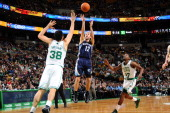 Nick Calathes of the Memphis Grizzlies shoots the ball against Vitor Faverani of the Boston Celtics on November 27 2013 at the TD Garden in Boston...