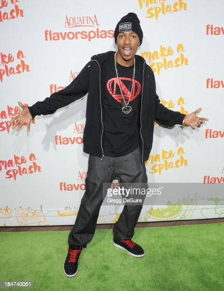 Nick Cannon arrives at the Aquafina FlavorSplash Launch Party at Sony Pictures Studios on October 15 2013 in Culver City California