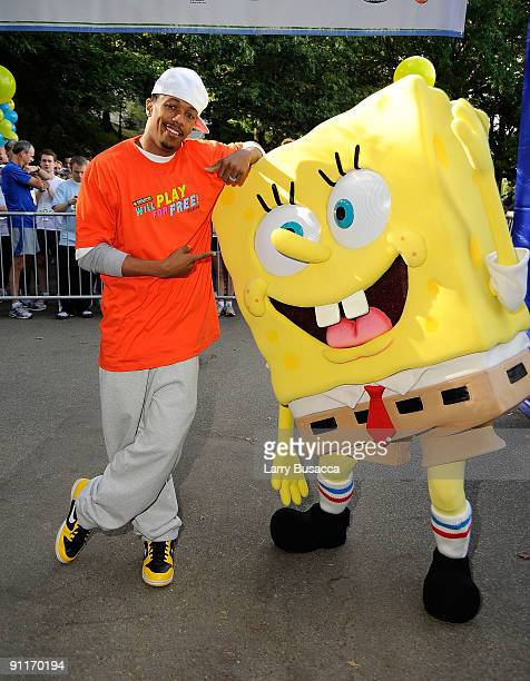 Nick Cannon poses with character Spongebob at Nickelodeon's Sixth Annual Worldwide Day of Play with NYC Big Brothers and Big Sisters at Riveride Park...