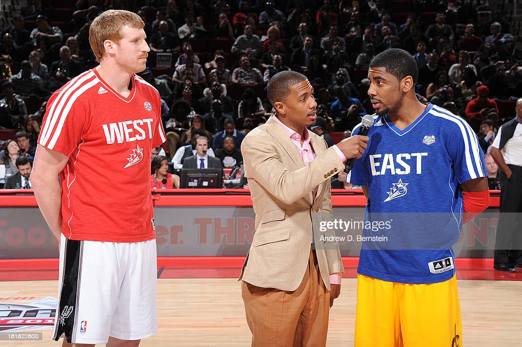 Nick Cannon speaks with Kyrie Irving #2 of the Cleveland Cavaliers and Matt Bonner #15 of the San Antonio Spurs during the 2013 Foot Locker Three-Point Contest on State Farm All-Star Saturday Night as part of 2013 NBA All-Star Weekend on February 16, 2013 at Toyota Center in Houston, Texas.
