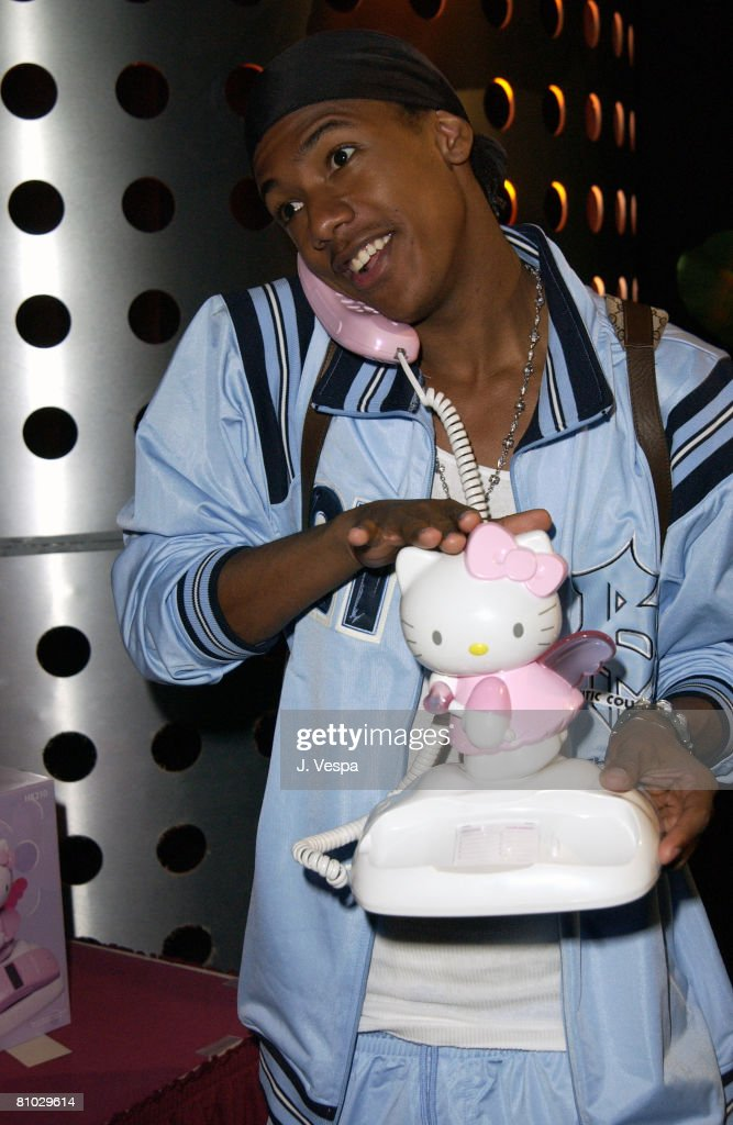 Nick Cannon with a Hello Kitty phone