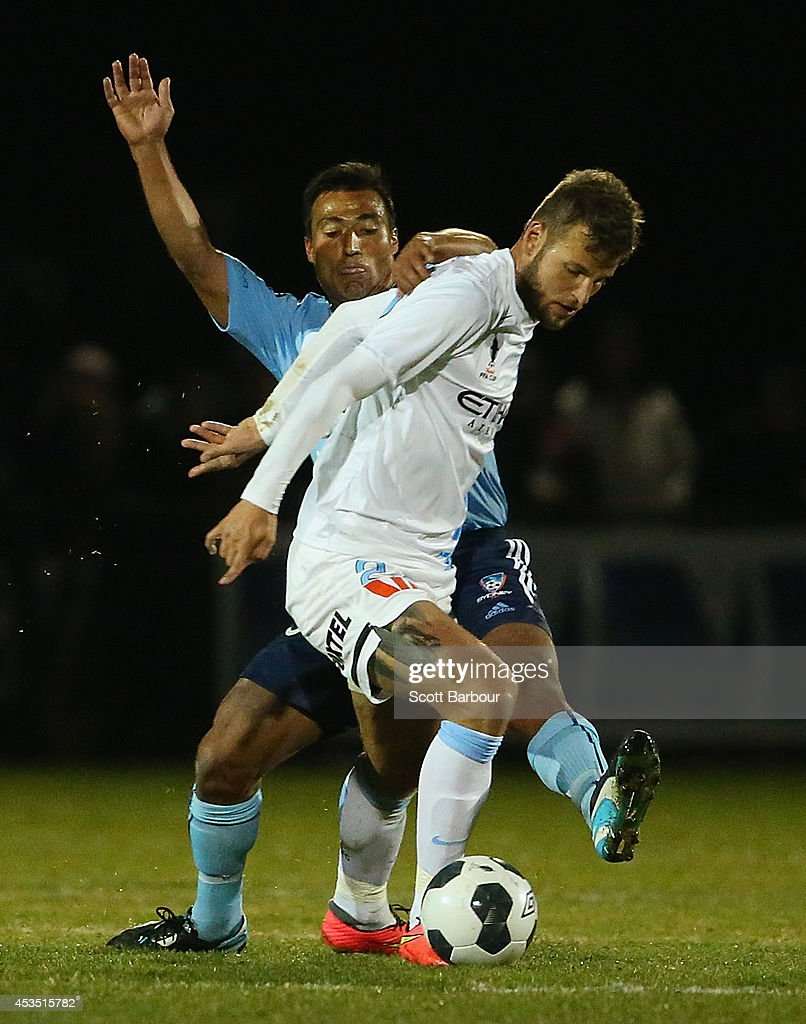 <a gi-track='captionPersonalityLinkClicked' href=/galleries/search?phrase=Nick+Carle&family=editorial&specificpeople=724338 ng-click='$event.stopPropagation()'>Nick Carle</a> of Sydney FC and Nick Kalmar of City compete for the ball during the FFA Cup match between Melbourne City and Sydney FC at Morshead Park Stadium on August 12, 2014 in Ballarat, Australia.