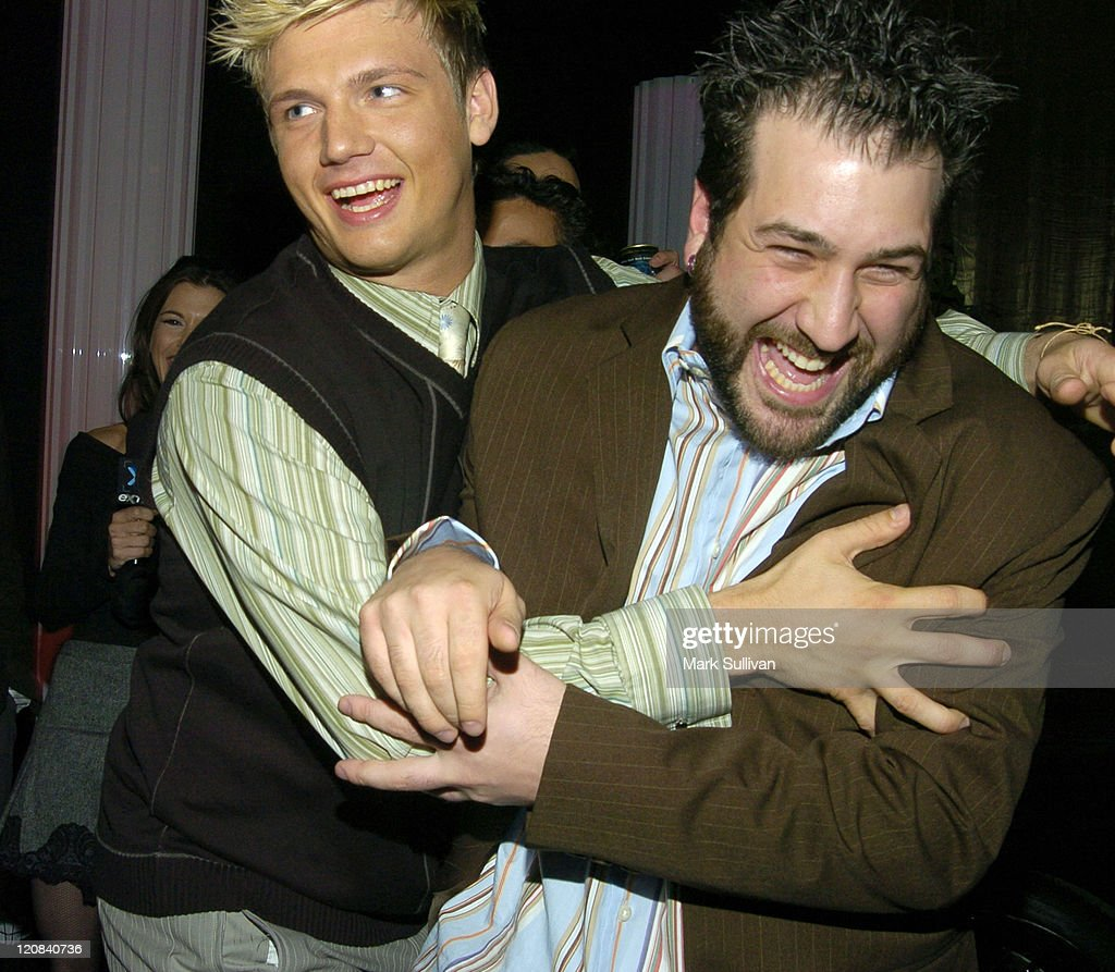 Nick Carter pushes Joey Fatone out of Backstreet Boys interview in Backstage Creations Talent Retreat at 2004 Motown 45 Special