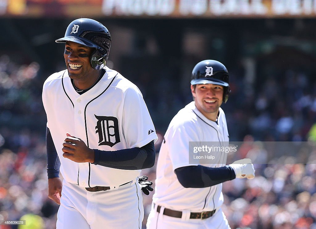 Nick Castellanos #9 of the Detroit Tigers celebrates with teammate Austin Jackson #14 after hitting a two run home run in the second inning during the game against the Los Angeles Angels of Anaheim at Comerica Park on April 19, 2014 in Detroit, Michigan.