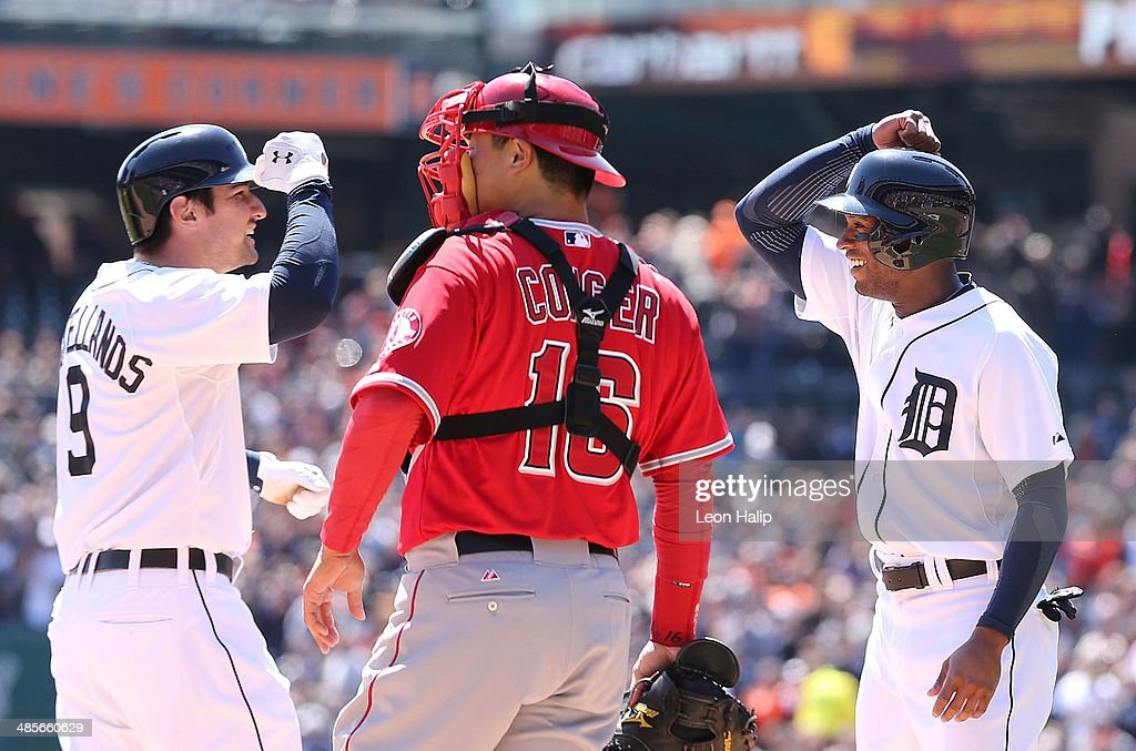 <a gi-track='captionPersonalityLinkClicked' href=/galleries/search?phrase=Nick+Castellanos&family=editorial&specificpeople=6129175 ng-click='$event.stopPropagation()'>Nick Castellanos</a> #9 of the Detroit Tigers celebrates with teammate <a gi-track='captionPersonalityLinkClicked' href=/galleries/search?phrase=Austin+Jackson&family=editorial&specificpeople=608633 ng-click='$event.stopPropagation()'>Austin Jackson</a> #14 after hitting a two run home run in the second inning during the game against the Los Angeles Angels of Anaheim at Comerica Park on April 19, 2014 in Detroit, Michigan. The Tigers defeated the Angels 5-2.