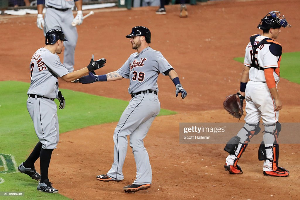 <a gi-track='captionPersonalityLinkClicked' href=/galleries/search?phrase=Nick+Castellanos&family=editorial&specificpeople=6129175 ng-click='$event.stopPropagation()'>Nick Castellanos</a> #9 of the Detroit Tigers (L) greets <a gi-track='captionPersonalityLinkClicked' href=/galleries/search?phrase=Jarrod+Saltalamacchia&family=editorial&specificpeople=836404 ng-click='$event.stopPropagation()'>Jarrod Saltalamacchia</a> #39 after Saltalamacchia hit a two-run home run in the sixth inning of their game against the Houston Astros at Minute Maid Park on April 16, 2016 in Houston, Texas.