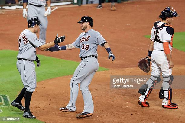 Nick Castellanos of the Detroit Tigers greets Jarrod Saltalamacchia after Saltalamacchia hit a tworun home run in the sixth inning of their game...