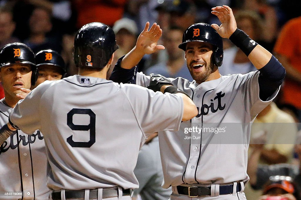 Nick Castellanos of the Detroit Tigers is congratulated by JD Martinez of the Detroit Tigers after hitting a grand slam home run against the Chicago...