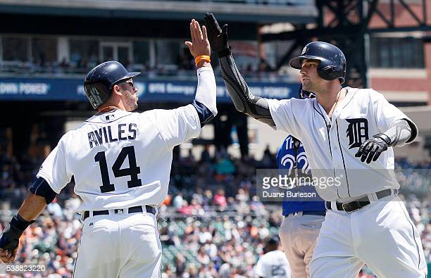 Nick Castellanos of the Detroit Tigers is congratulated by Mike Aviles of the Detroit Tigers after hitting a tworun home run against the Toronto Blue...