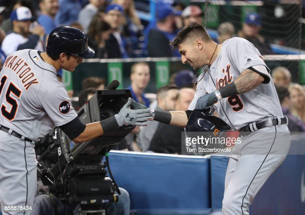 Nick Castellanos of the Detroit Tigers is congratulated by Mikie Mahtook after hitting a grand slam home run in the third inning during MLB game...