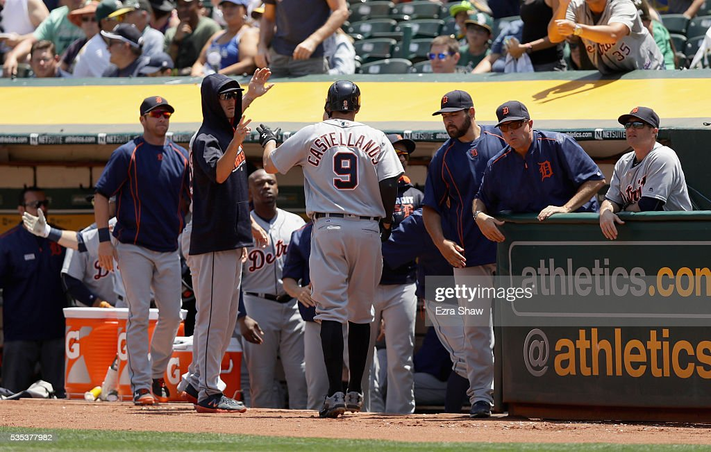 <a gi-track='captionPersonalityLinkClicked' href=/galleries/search?phrase=Nick+Castellanos&family=editorial&specificpeople=6129175 ng-click='$event.stopPropagation()'>Nick Castellanos</a> #9 of the Detroit Tigers is congratulated by teammates after he scored in the second inning against the Oakland Athletics at the Coliseum on May 29, 2016 in Oakland, California.