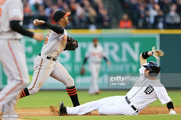 Nick Castellanos of the Detroit Tigers is forced out at second by Jonathan Schoop of the Baltimore Orioles in the seventh inning during Game Three of...