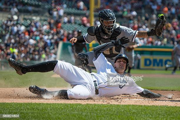 Nick Castellanos of the Detroit Tigers is tagged out at home plate in the first inning by catcher Omar Narvaez of the Chicago White Sox during a MLB...