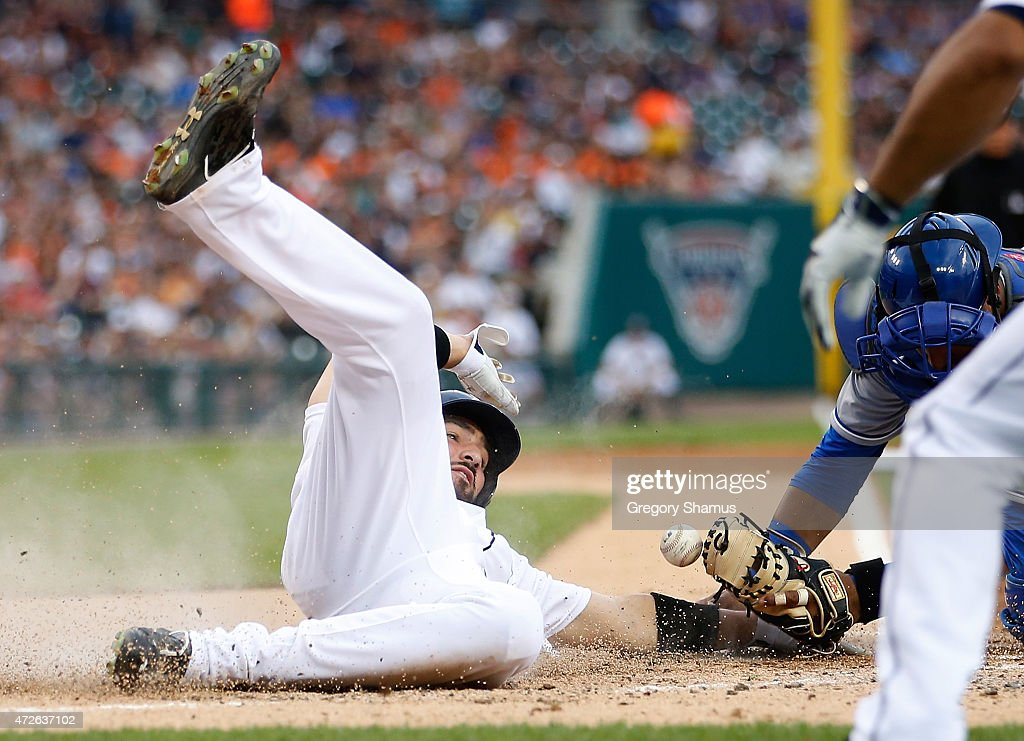 <a gi-track='captionPersonalityLinkClicked' href=/galleries/search?phrase=Nick+Castellanos&family=editorial&specificpeople=6129175 ng-click='$event.stopPropagation()'>Nick Castellanos</a> #9 of the Detroit Tigers slides safely into home plate prior to a tag by Salvador Perez #13 of the Kansas City Royals during the second inning at Comerica Park on May 8, 2015 in Detroit, Michigan.