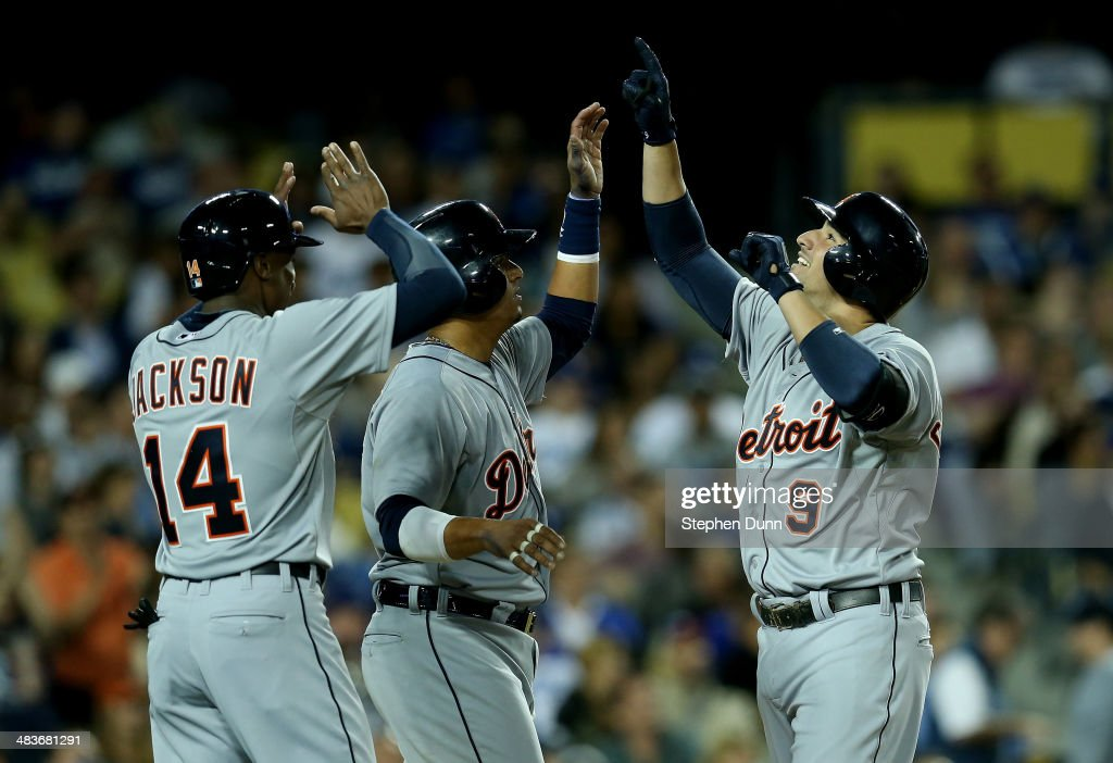 <a gi-track='captionPersonalityLinkClicked' href=/galleries/search?phrase=Nick+Castellanos&family=editorial&specificpeople=6129175 ng-click='$event.stopPropagation()'>Nick Castellanos</a> #9, Victor Martinez #1, and <a gi-track='captionPersonalityLinkClicked' href=/galleries/search?phrase=Austin+Jackson&family=editorial&specificpeople=608633 ng-click='$event.stopPropagation()'>Austin Jackson</a> #14 of the Detroit Tigers celebrate after all three score on Castellanos' three run home run in the third inning against the Los Angeles Dodgers at Dodger Stadium on April 9, 2014 in Los Angeles, California.