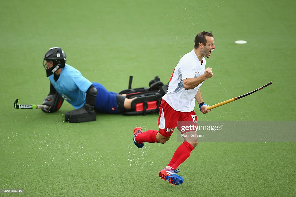 Nick Catlin of England celebrates scoring a penalty against Goalkeeper Devon Manchester of New Zealnd during a penalty shoot out in the bronze medal match between New Zealand and England at Glasgow National Hockey Centre during day eleven of the Glasgow 2014 Commonwealth Games on August 3, 2014 in Glasgow, United Kingdom.
