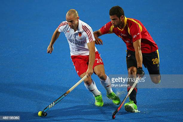 Nick Catlin of England is tackled by Salvador Piera of Spain during the match between England and Spain on day five of the Unibet EuroHockey...