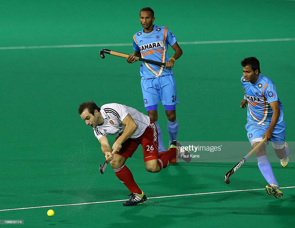 Nick Catlin of England passes the ball in the England v India game during day one of the 2012 International Super Series at Perth Hockey Stadium on November 22, 2012 in Perth, Australia.