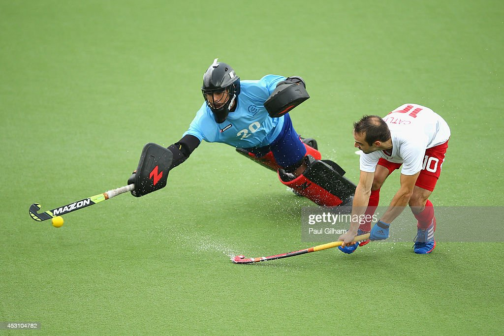 Nick Catlin of England takes a penalty against Goalkeeper Devon Manchester of New Zealnd during a penalty shoot out in the bronze medal match between New Zealand and England at Glasgow National Hockey Centre during day eleven of the Glasgow 2014 Commonwealth Games on August 3, 2014 in Glasgow, United Kingdom.