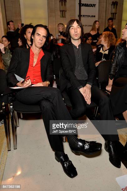 Nick Cave and Bobby Gillespie attend the Pam Hogg show during London Fashion Week September 2017 on September 15 2017 in London England
