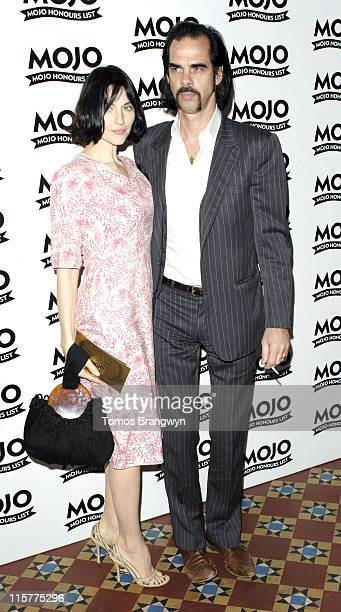 Nick Cave and guest during Mojo Honours List 2006 – Arrivals at Shoreditch Town Hall in London Great Britain