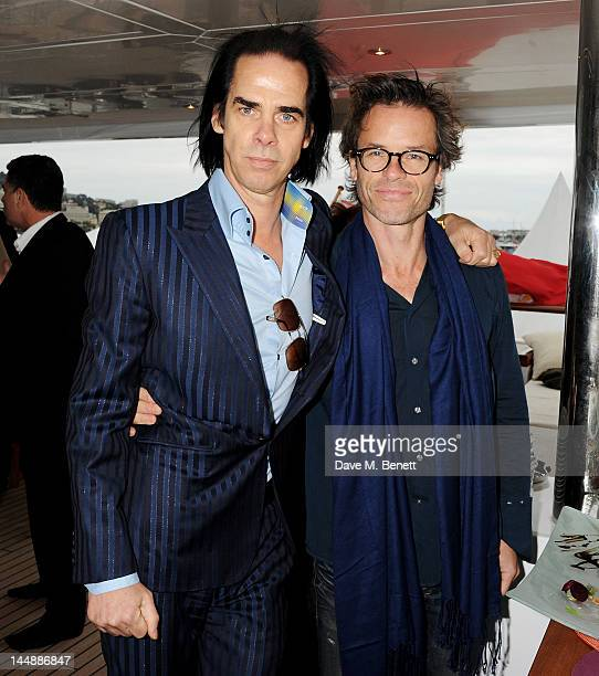 Nick Cave and Guy Pearce attend a lunch hosted by Len Blavatnik Harvey Weinstein and Warner Music during the 65th Cannes Film Festival on board the...