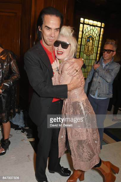 Nick Cave and Pam Hogg pose backstage at the Pam Hogg SS18 catwalk show during London Fashion Week September 2017 on September 15 2017 in London...