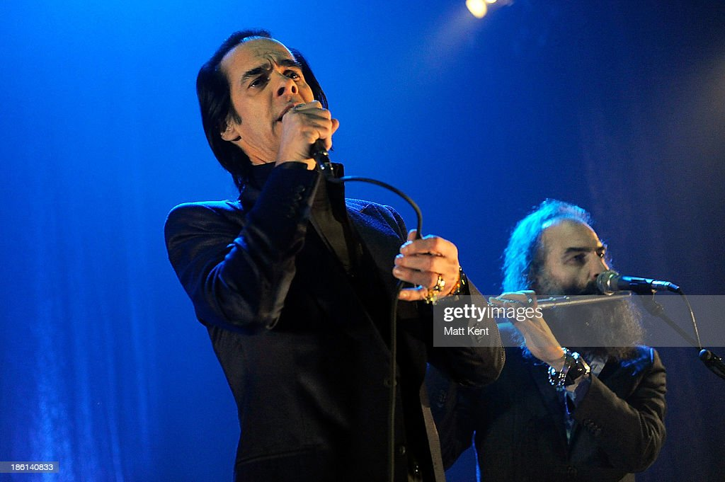 <a gi-track='captionPersonalityLinkClicked' href=/galleries/search?phrase=Nick+Cave&family=editorial&specificpeople=212755 ng-click='$event.stopPropagation()'>Nick Cave</a> (L) and <a gi-track='captionPersonalityLinkClicked' href=/galleries/search?phrase=Warren+Ellis&family=editorial&specificpeople=4451382 ng-click='$event.stopPropagation()'>Warren Ellis</a> performs with The Bad Seeds at Hammersmith Apollo on October 28, 2013 in London, England.