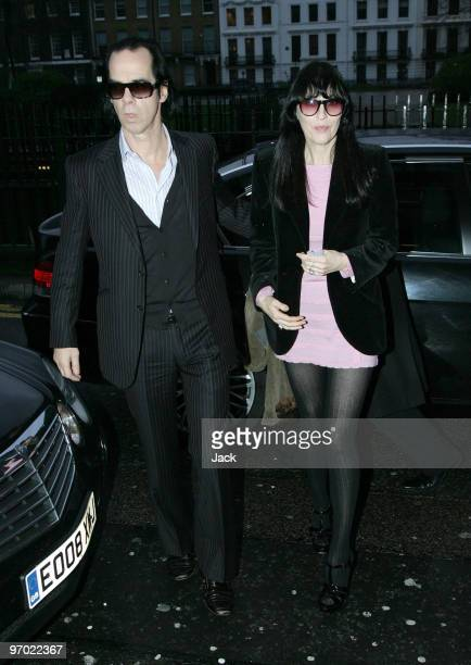 Nick Cave and wife Susie Bick arriving at the Pam Hogg fashion show on February 22 2010 in London England