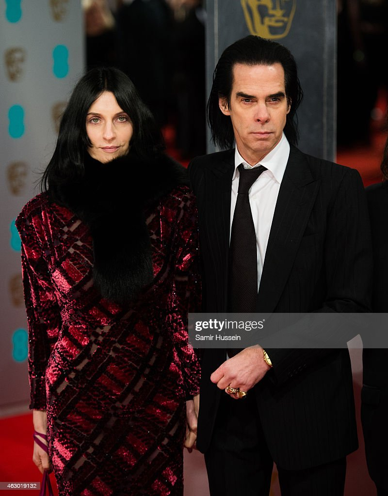 Nick Cave and wife Susie Bick attend the EE British Academy Film Awards at The Royal Opera House on February 8 2015 in London England