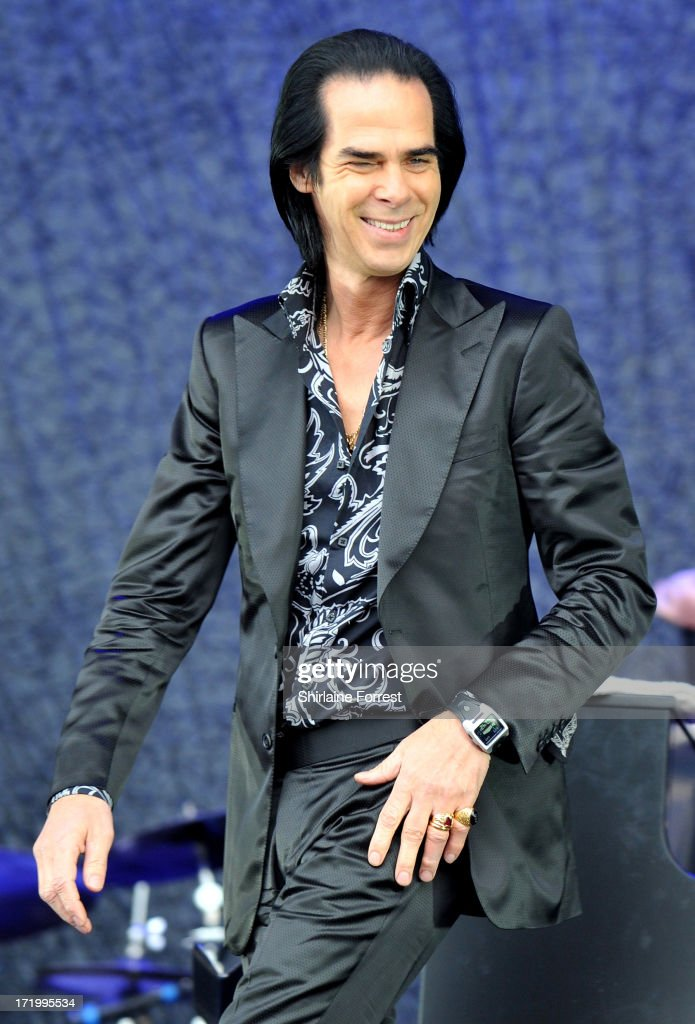<a gi-track='captionPersonalityLinkClicked' href=/galleries/search?phrase=Nick+Cave&family=editorial&specificpeople=212755 ng-click='$event.stopPropagation()'>Nick Cave</a> of <a gi-track='captionPersonalityLinkClicked' href=/galleries/search?phrase=Nick+Cave&family=editorial&specificpeople=212755 ng-click='$event.stopPropagation()'>Nick Cave</a> and the Bad Seeds performs at day 4 of the 2013 Glastonbury Festival at Worthy Farm on June 30, 2013 in Glastonbury, England.