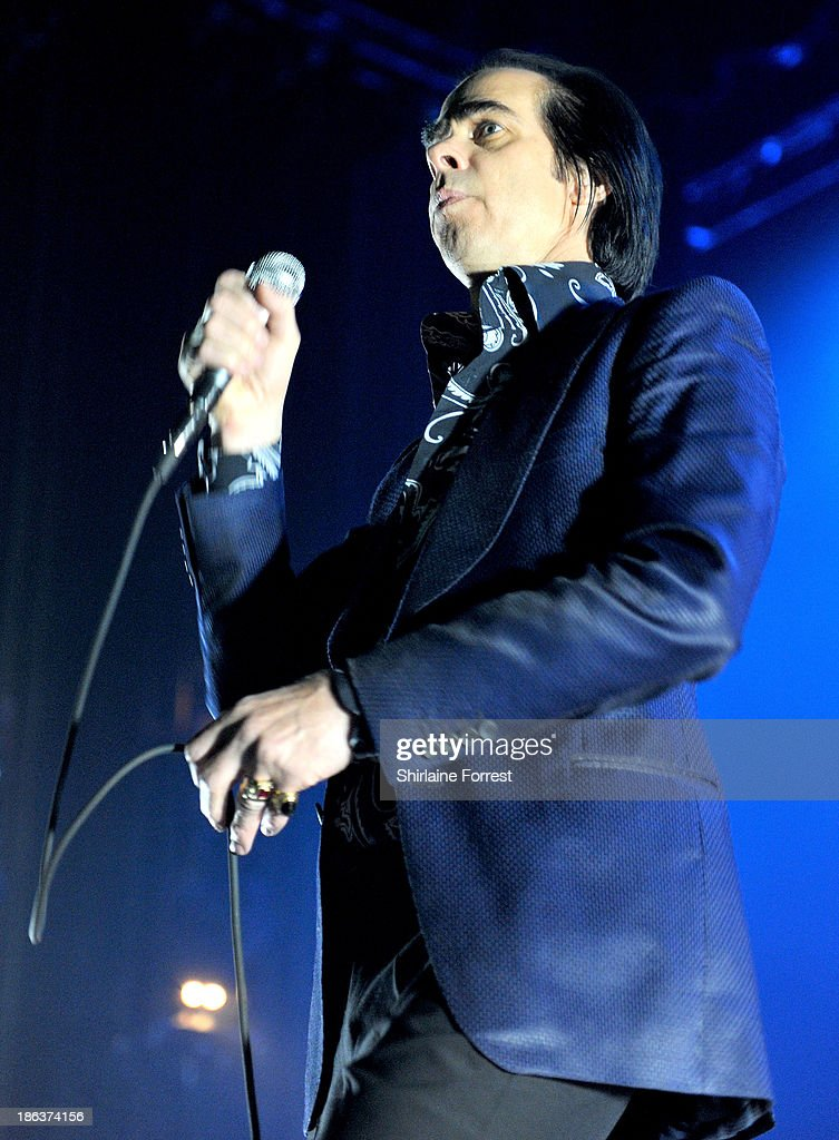 <a gi-track='captionPersonalityLinkClicked' href=/galleries/search?phrase=Nick+Cave&family=editorial&specificpeople=212755 ng-click='$event.stopPropagation()'>Nick Cave</a> of <a gi-track='captionPersonalityLinkClicked' href=/galleries/search?phrase=Nick+Cave&family=editorial&specificpeople=212755 ng-click='$event.stopPropagation()'>Nick Cave</a> and The Bad Seeds performs at Manchester Apollo on October 30, 2013 in Manchester, England.