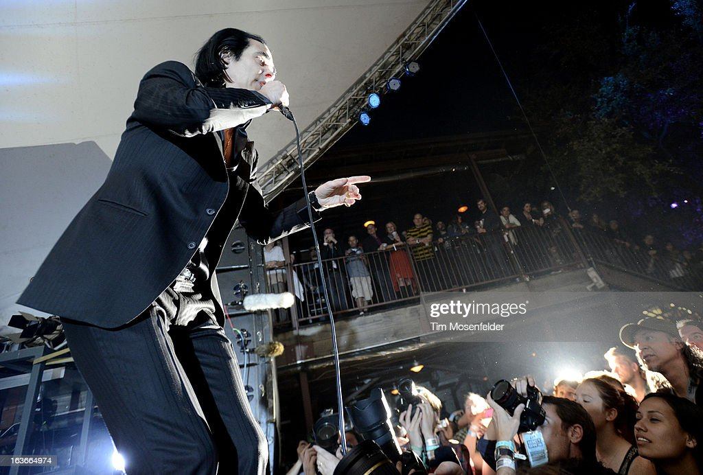<a gi-track='captionPersonalityLinkClicked' href=/galleries/search?phrase=Nick+Cave&family=editorial&specificpeople=212755 ng-click='$event.stopPropagation()'>Nick Cave</a> of <a gi-track='captionPersonalityLinkClicked' href=/galleries/search?phrase=Nick+Cave&family=editorial&specificpeople=212755 ng-click='$event.stopPropagation()'>Nick Cave</a> and the Bad Seeds performs at the NPR Showcase at Stubbs Bar-B-Que on March 13, 2013 in Austin, Texas.