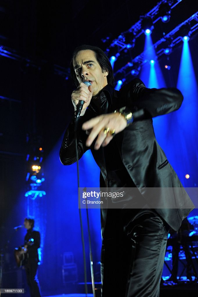 <a gi-track='captionPersonalityLinkClicked' href=/galleries/search?phrase=Nick+Cave+-+Musician&family=editorial&specificpeople=212755 ng-click='$event.stopPropagation()'>Nick Cave</a> of <a gi-track='captionPersonalityLinkClicked' href=/galleries/search?phrase=Nick+Cave+-+Musician&family=editorial&specificpeople=212755 ng-click='$event.stopPropagation()'>Nick Cave</a> And The Bad Seeds performs on stage at Hammersmith Apollo on October 26, 2013 in London, England.