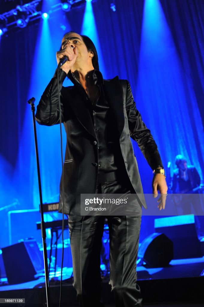 Nick Cave of Nick Cave And The Bad Seeds performs on stage at Hammersmith Apollo on October 26, 2013 in London, England.