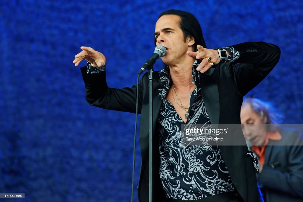 <a gi-track='captionPersonalityLinkClicked' href=/galleries/search?phrase=Nick+Cave+-+Musician&family=editorial&specificpeople=212755 ng-click='$event.stopPropagation()'>Nick Cave</a> of <a gi-track='captionPersonalityLinkClicked' href=/galleries/search?phrase=Nick+Cave+-+Musician&family=editorial&specificpeople=212755 ng-click='$event.stopPropagation()'>Nick Cave</a> and the Bad Seeds performs on stage on Day 4 of Glastonbury Festival at Worthy Farm on June 30, 2013 in Glastonbury, England.