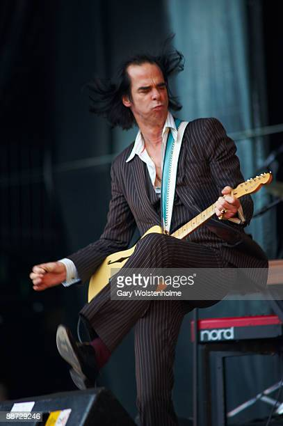 Nick Cave of Nick Cave and the Bad Seeds performs on stage on the last day of Glastonbury Festival at Worthy Farm on June 28 2009 in Glastonbury...