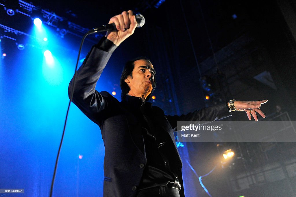 <a gi-track='captionPersonalityLinkClicked' href=/galleries/search?phrase=Nick+Cave&family=editorial&specificpeople=212755 ng-click='$event.stopPropagation()'>Nick Cave</a> performs with The Bad Seeds at Hammersmith Apollo on October 28, 2013 in London, England.