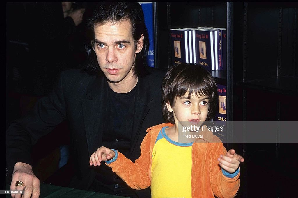 Nick Cave with his son Luke during Nick Cave 'King Ink II' Book Signing March 1 1997 at Waterstones in London Great Britain