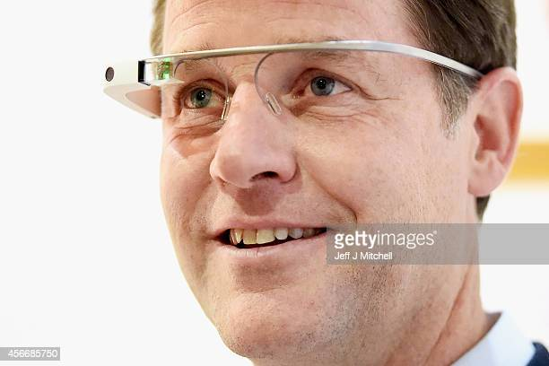 Nick Clegg Deputy Prime Minister try on a pair of Google Glass headsets during a tour of the exhibition stands at Liberal Democrat Autumn conference...