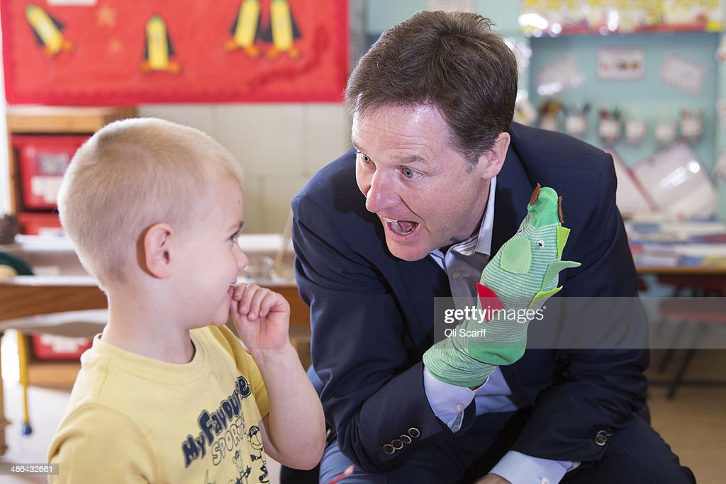 Nick Clegg the Deputy Prime Minister and leader of the Liberal Democrats chats to Dom Bearman aged 4 as he plays with a sock puppet at Nannas Day...