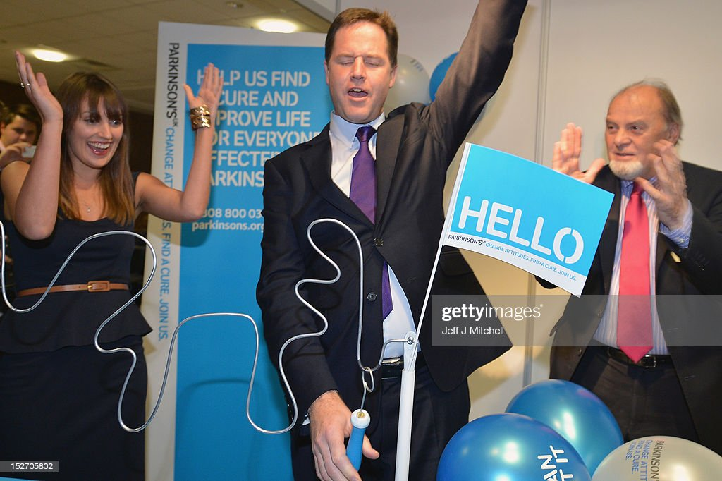 Nick Clegg, the Deputy Prime Minister, plays a buzzer game as he tours the stalls at the Liberal Democrat conference on September 24, 2012 in Brighton, England. Business Secretary Vince Cable will announce the government's plan to invest one billion GBP into setting up a bank to increase lending to businesses, who have struggled to obtain credit since the financial crisis.
