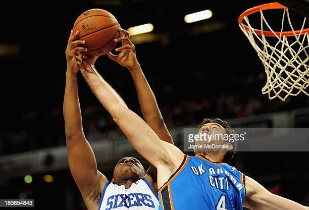 Nick Collinson of Oklahoma City tussles with Kwame Brown of Philadelphia 76ers during the NBA pre season match between Oklahoma City Thunder and...