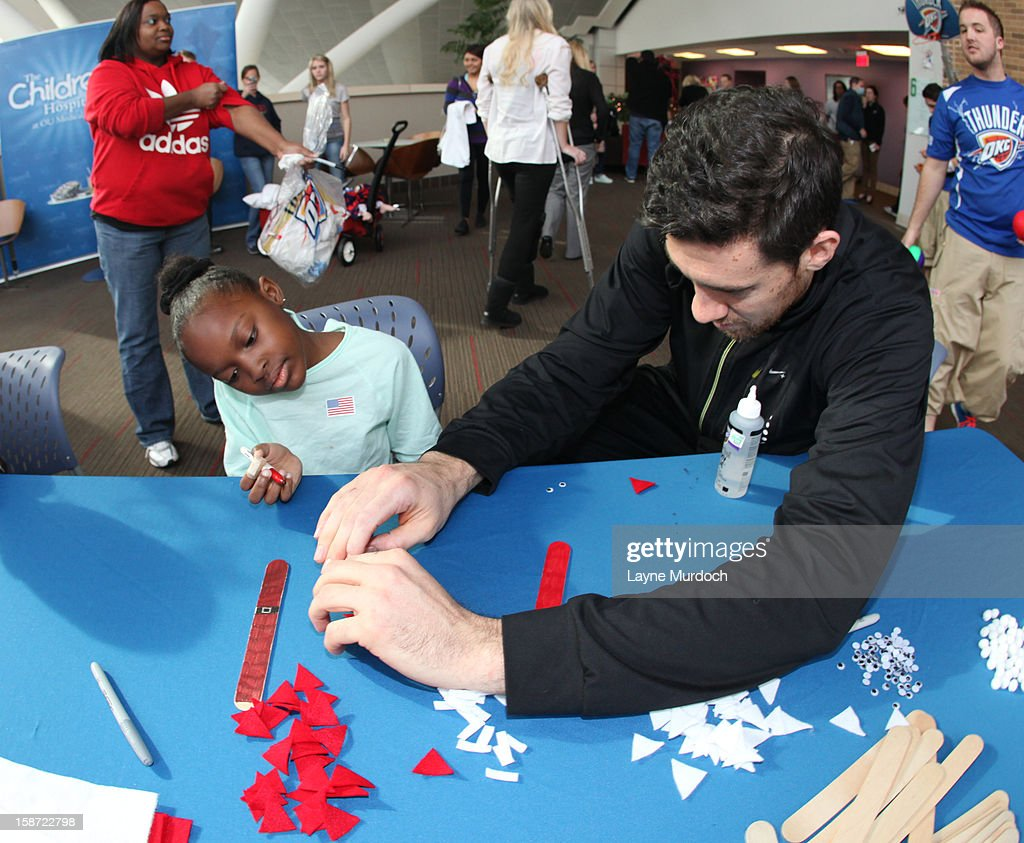 Nick Collison #4 of the Oklahoma City Thunder along with the rest of the team, visits patients in the Children's Hospital on December 22, 2012 in Oklahoma City, Oklahoma.