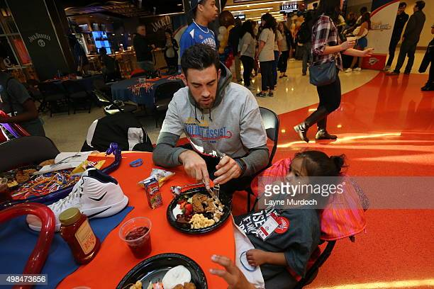 Nick Collison of the Oklahoma City Thunder and other players host 100 children from Novo Ministries for an evening of food and fun on November 21...